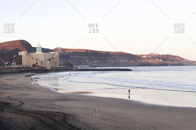 Playa de Las Canteras, Gran Canaria, Canary Islands, Spain - December 1, 2017: Sunrise on the beach of Las Palmas with Alfredo Kraus Auditorium
