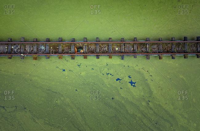 Abandoned rails over a lake