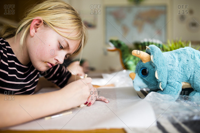 Girl using a brush to make a craft
