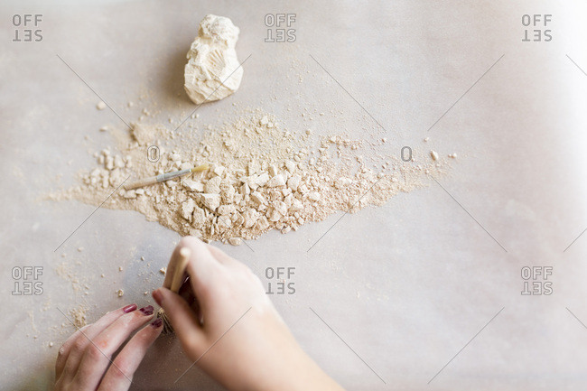 Girl making a craft from plaster