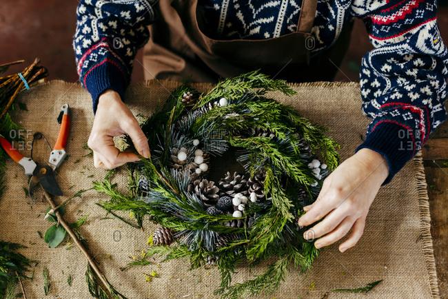 Woman making Christmas wreath