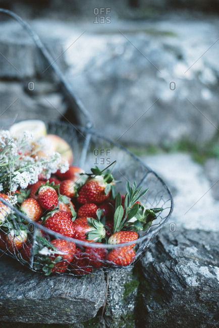 Basket with strawberries and apples