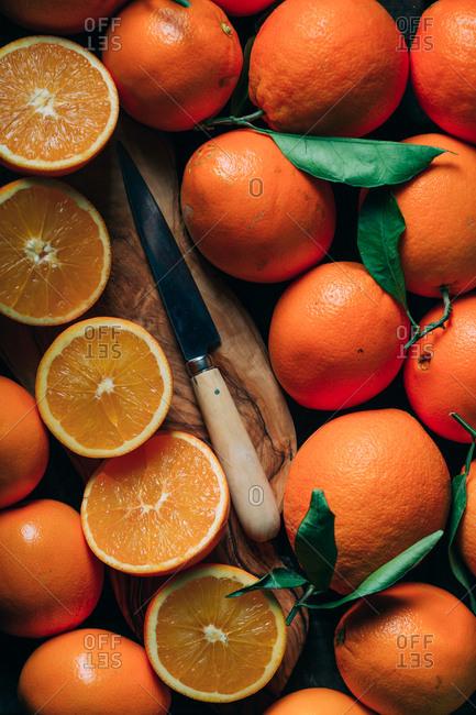 Fresh oranges and glass with orange juice