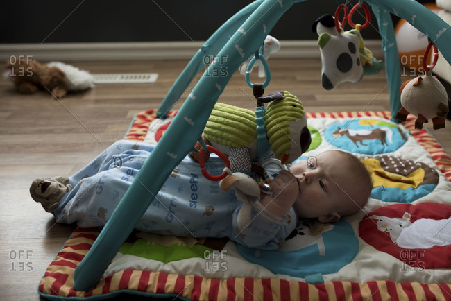 Baby playing alone with toy mat
