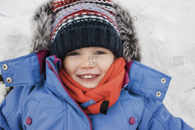 Close-up portrait of girl wearing warm clothing