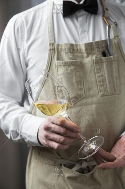 Server preparing glass of wine