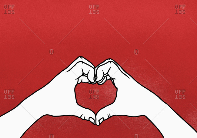 Cropped hands of person making heart shape against red background