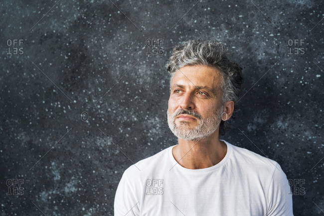 Portrait of a mature man- looking up- thinking