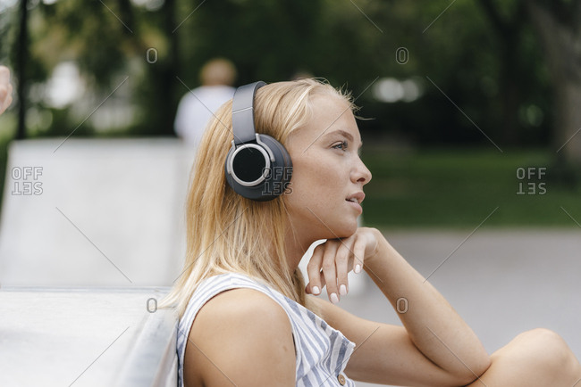 Young woman with headphones listening to music outdoors