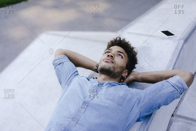 Portrait of relaxed man lying in skate park