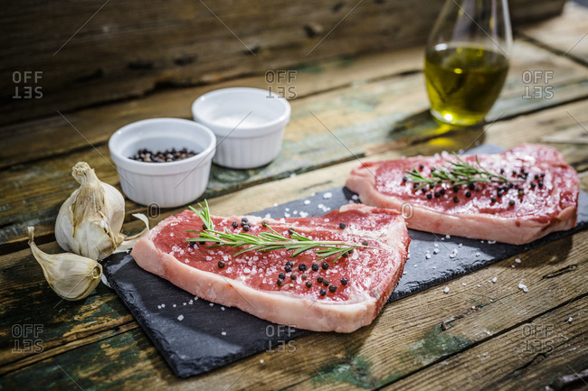 Raw beefsteak with rosemary- salt and pepper