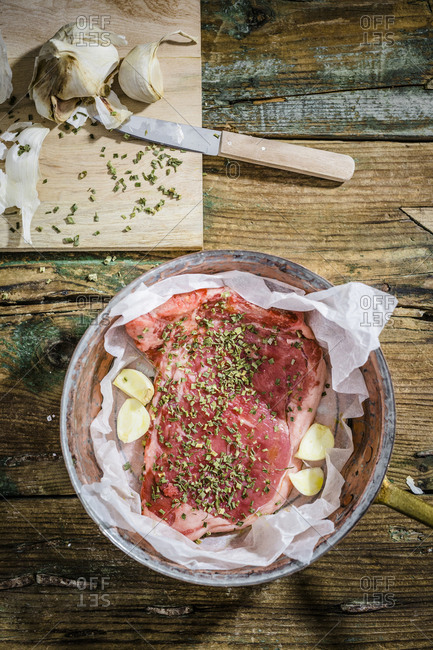 Row beefsteak with herbs and garlic