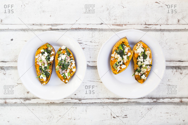 Filled sweet potato with spinach- red onion- couscous- feta and coriander