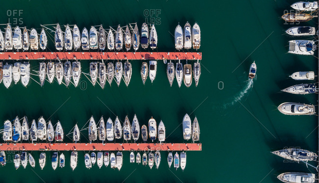 Overhead view of boats moored along the jetty at harbor