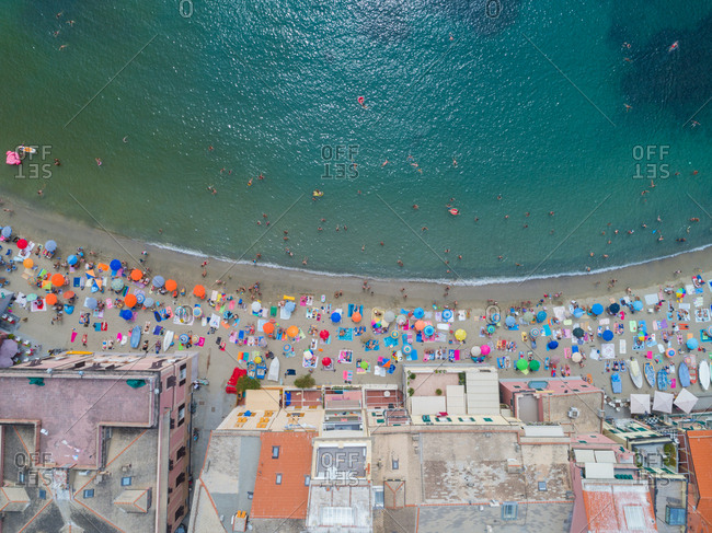 Overhead view of beach umbrellas and building along the sea coast