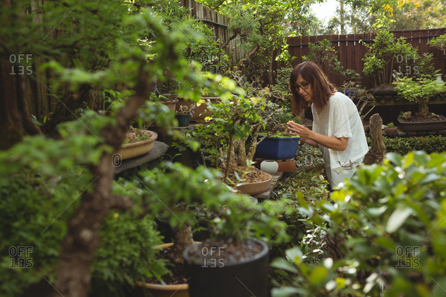 Woman working in garden on a sunny