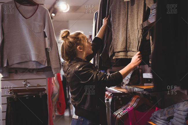 Beautiful woman shopping for clothes in mall