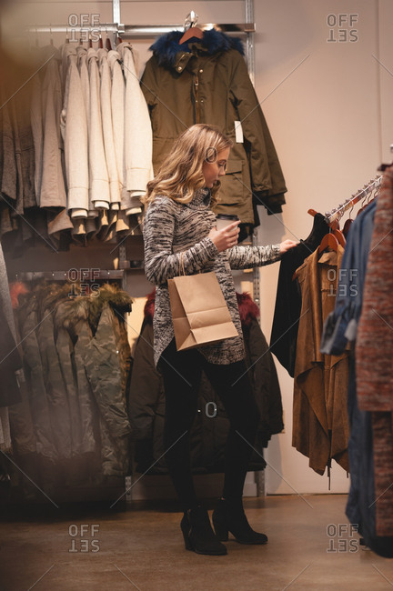 Beautiful woman shopping for clothes in the mall