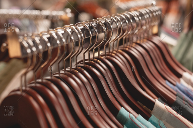 Close-up of clothes hanger arranged on rack