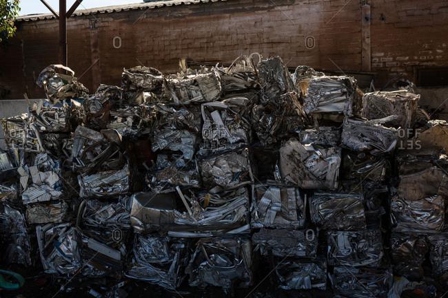 Bundles of compressed trash in the scrapyard