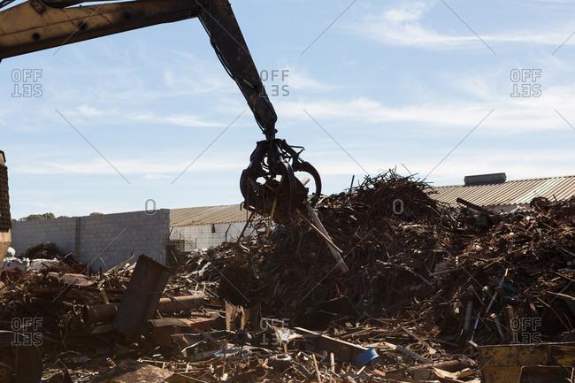 Crane lifting scrap metal in the junkyard