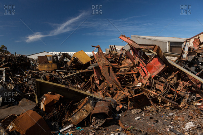 Rusty metal pieces in the scrapyard on a sunny day