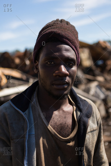 Portrait of worker looking at camera in the scrapyard