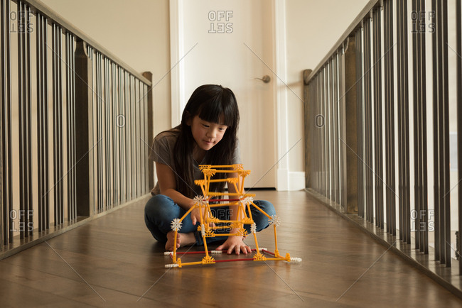 Adorable girl playing with toy at home