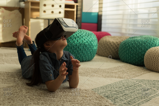 Girl using virtual reality headset in living room at home
