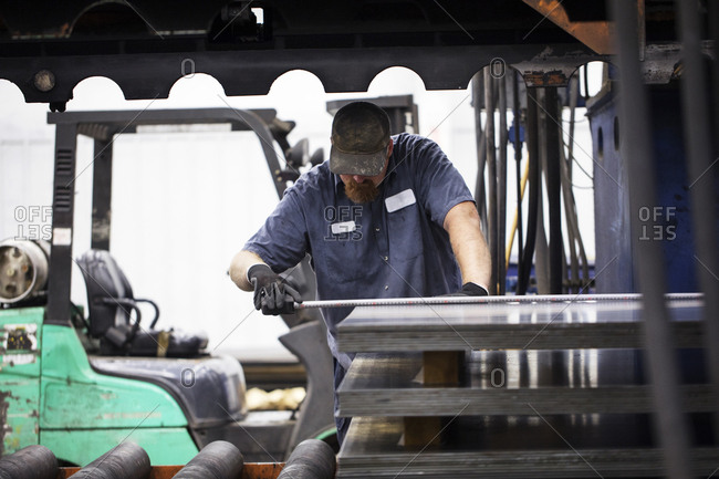 Worker working on metal sheet in Steel Industry Factory