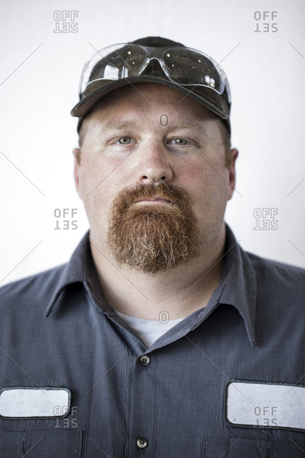 Portrait of confident worker against white background