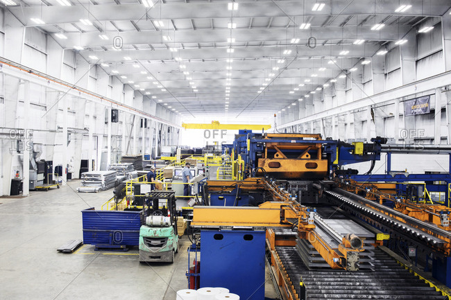 High angle view of machineries in storage room