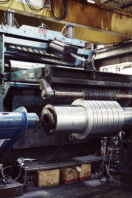 Metal sheets spinning on machine at industry