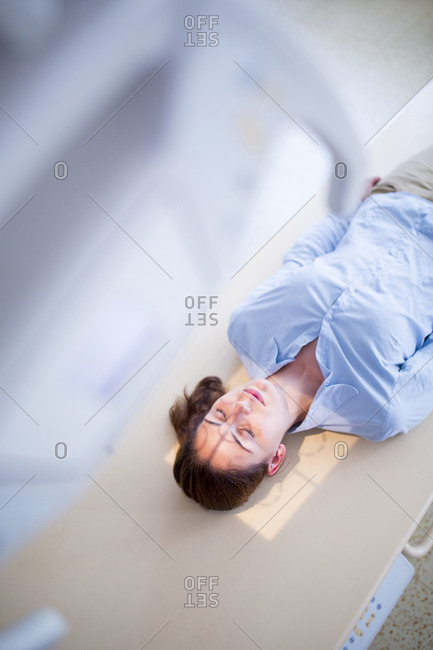 X-ray machine with patient lying down