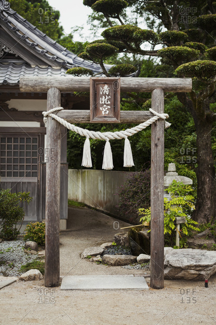 Traditional wooden gate outside a Japanese Buddhist temple