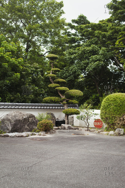 Garden of a Japanese Buddhist temple with rocks and trees