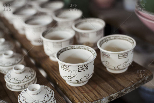 High angle close up of white cups and lids in a Japanese porcelain workshop