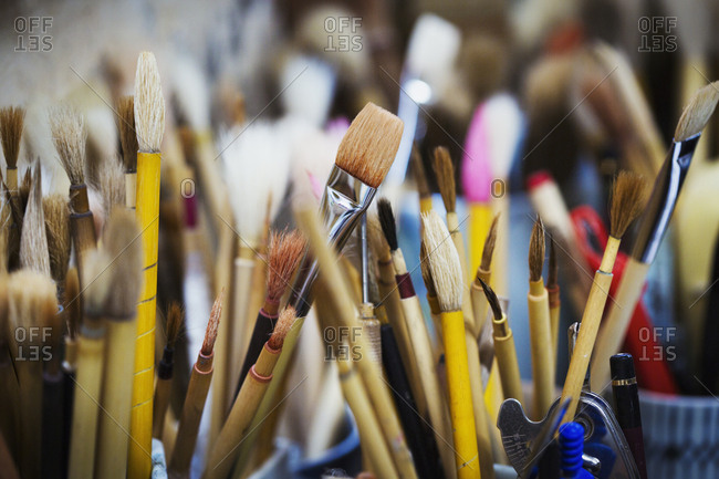 Close up of a selection of paintbrushes in a Japanese porcelain workshop