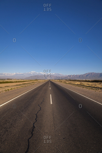 Paved road in desert landscape, Mendoza, Argentina, South America
