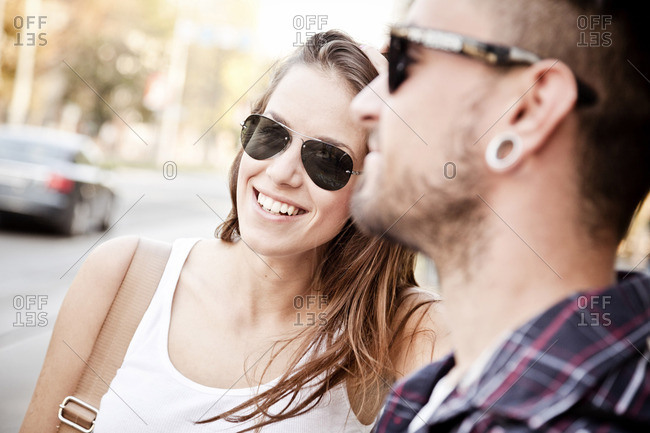 Portrait of young couple with sunglasses