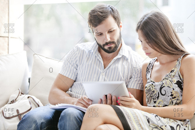 Young couple using digital laptop together