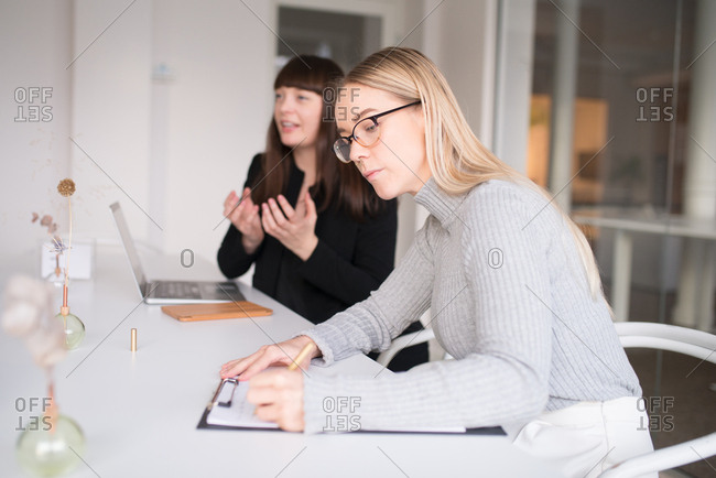 Two women brainstorming in an office