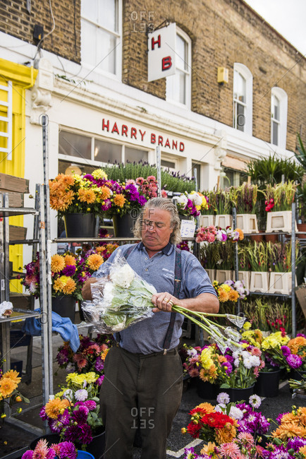 London, England - August 5, 2017: Vendor at the Columbia Road Flower Market