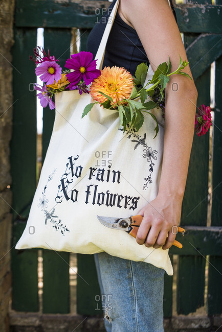 Young farm worker holding eco-conscious tote bag