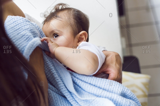 Mother holding baby son (6-11 months)