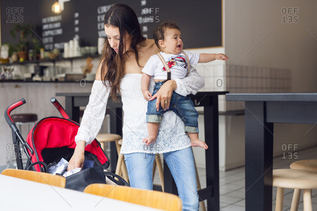 Mother with baby son (6-11 months) in cafe