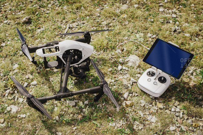 Drone and remote control on grass