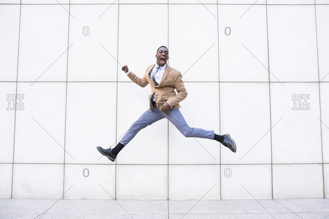 Young man caught mid air doing splits