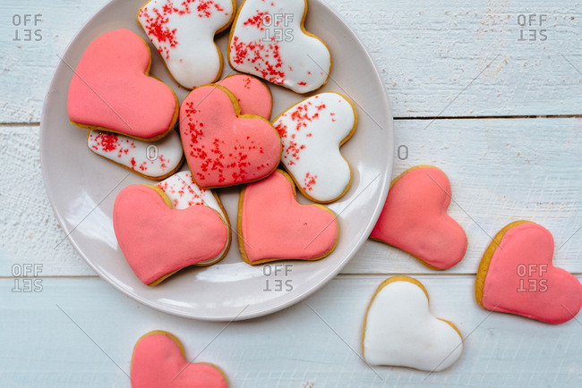 A plateful of white and pink heart-shaped gingerbread cookies