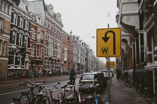 Amsterdam, Netherlands - November 16,2017: Bikes on a busy Amsterdam street